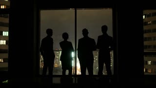 Business team meeting in office and talk at night