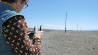 Close Up Of Man Flying Drone Over Coastal Landscape 20s 4k