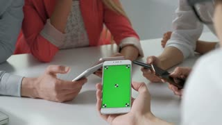Concept of teamwork main focus on left phones. Phone with greenscreen 4k 20s 30s
