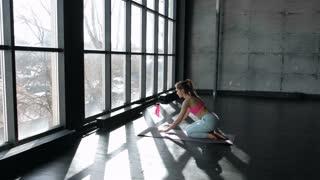 Female performing yoga asanas on the floor. Downward dog and cobra pose 20s 4k