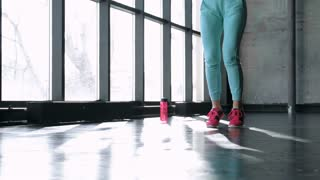 Fitness concept. Healthy lifestyle. Young slim woman jumping with skipping rope in gym. 20s 4k 20s 4k