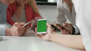 Group of friends having fun together with smartphones - Closeup of hands social networking with mobile cellphones - Wifi connected people in bar Technology and phone addiction concept - 20s 4k.