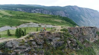 Group of people go down the path in the mountains. Slow motion shot. Back view. aerial slow motion 4k,