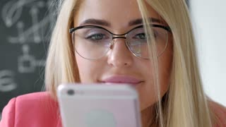 joyful smiling young businesswoman having negotiations by phone in office close up 20s 4k