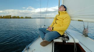 One man sitting on the yacht and look at horizon