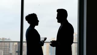 Partnership: woman and man silhouette discussing