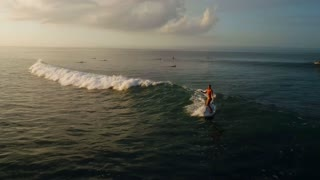 Surfing: Surfer woman riding on the blue waves slow motion
