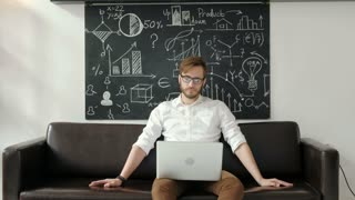 technology and lifestyle concept - man working with laptop at home 20s 4k.