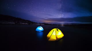 Time lapse of Milky Way over the viewing field and camping tents at Ngorongoro crater, Tanzania.