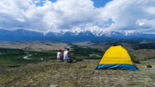 tourist tent camping in mountains aerial slow motion 4k.