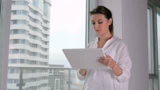 Young businesswoman using tablet in office