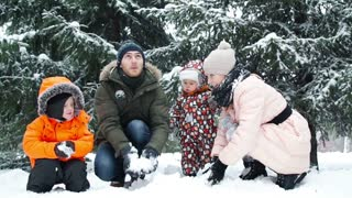 Winter fun, snow, family sledding at winter time