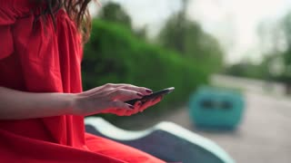 woman in red dress holding a phone with app mobile wallet