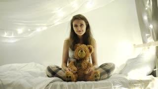 Woman with teddy bear 4k 20s,