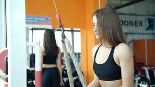 Women working out lifting weights. 20s. 1080p Slow Motion