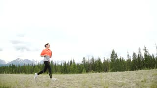 Young Athletic Woman Running on Mountain Trail. POV Follow Cam. Sunset Workout in Nature. Slow Motion