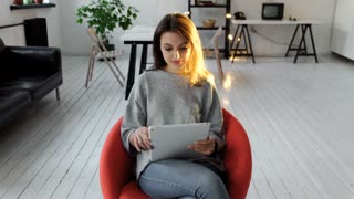 young beautiful business woman sitting at a table with tablet in hands. 4k 20s