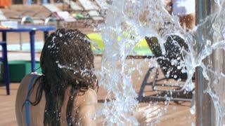 Young beautiful woman taking a shower outdoors in bikini Super Slow Motion 240fps.