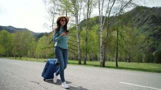 Young woman with travel bag and phone