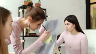 Young womans working on painting in a workshop 4k 20s