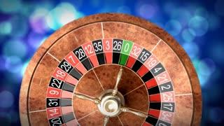 Casino roulette wheel against defocused background