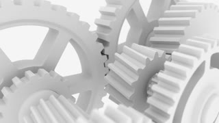 Rotating white cogwheels