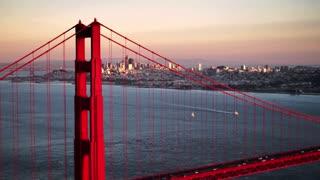 Aerial shot of Golden Gate Bridge in front of San Francisco skyline