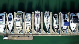Aerial view looking straight down at boats docked by pier 2