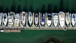 Aerial view looking straight down at boats docked by pier 3