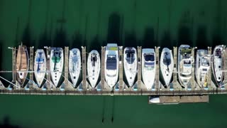 Aerial view looking straight down at boats docked by pier 4