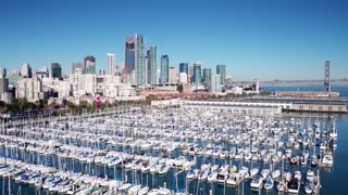 Aerial view of boats docked and San Francisco skyline