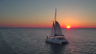 Aerial view of couple on sailboat at sunset 2