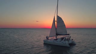 Aerial view of couple on sailboat at sunset 3