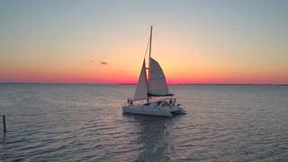 Aerial view of couple on sailboat at sunset 4