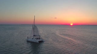 Aerial view of couple on sailboat at sunset 6