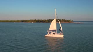 Aerial view of couple on sailboat in evening 2