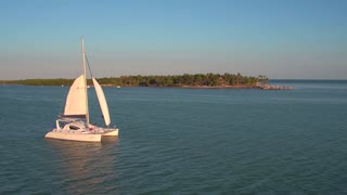 Aerial view of couple on sailboat in evening 3