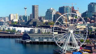 Aerial view of ferris wheel in front of Seattle skyline 2