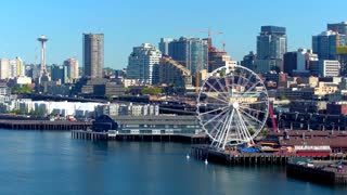 Aerial view of ferris wheel in front of Seattle skyline 3