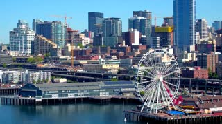 Aerial view of ferris wheel in front of Seattle skyline 4