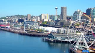 Aerial view of ferris wheel in front of Seattle skyline 5