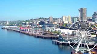 Aerial view of ferris wheel in front of Seattle skyline 6