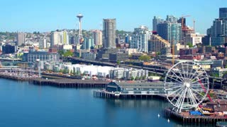 Aerial view of ferris wheel in front of Seattle skyline 7