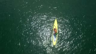 Aerial view of person paddle boarding in ocean