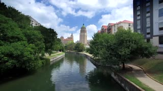 Aerial view of San Antonio riverwalk by skyline under sunny blue sky 2