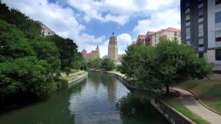 Aerial view of San Antonio riverwalk by skyline under sunny blue sky 2