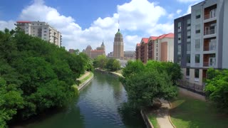 Aerial view of San Antonio riverwalk by skyline under sunny blue sky