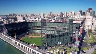 Aerial view of San Francisco baseball stadium and city skyline