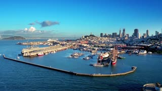 Aerial view of San Francisco Bay and boats with city in background 2