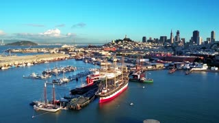 Aerial view of San Francisco Bay and boats with city in background 3